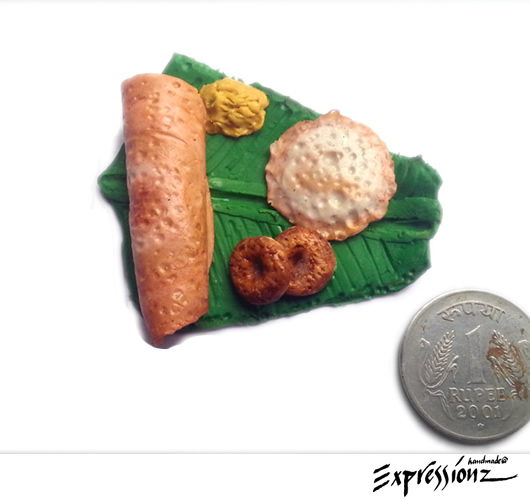 Miniature Dosa's and Chutney on Banana Leaf and Wooden Board