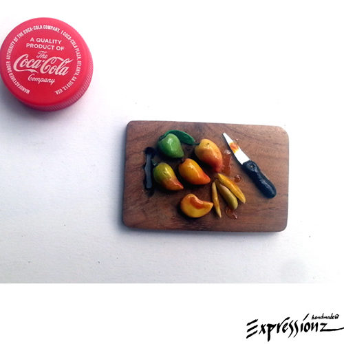 Mangoes on a wooden cutting board & knife