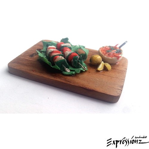 Miniature Cottage Cheese BBQ on a Cutting Board
